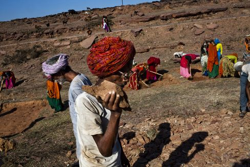 Elderly villagers work at a site as part of the National Rural Employment Guarantee Act at Nazir ka Mandir in the Karauli district of Rajasthan in Feb. 2011. Photographer: Sanjit Das/Panos