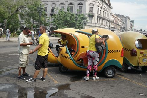 Havana's Coco Taxis, named for their coconut shape. Drivers rent their vehicles from a state company.