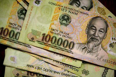 Vietnam Devalues Dong by a Record 7%, Seeking Curb Deficit