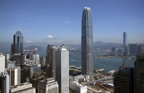 Hong Kong Chief Executive Leung Pledges Property Curbs to Stay