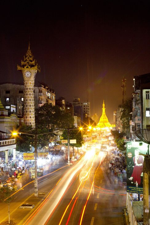 Traffic moves through the streets of Yangon, Myanmar. Photographer: Brent Lewin/Bloomberg