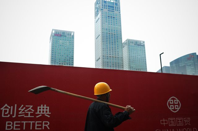 Despite talk of slower growth, China keeps building. Photographer:WANG ZHAO/AFP/Getty Images