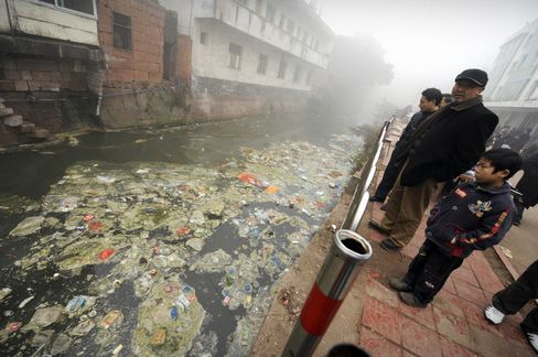 China, the world's worst polluter, needs to spend least 2 percent of gross domestic product a year -- 680 billion yuan at 2009 figures -- to clean up 30 years of industrial waste, said He Ping, chairman of the Washington-based International Fund for China's Environment. Photographer: Peter Park
