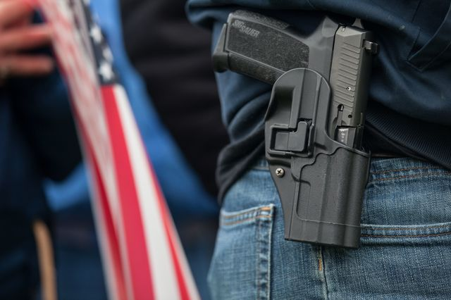 A gun on every hip? Photographer: David Ryder/Getty Images