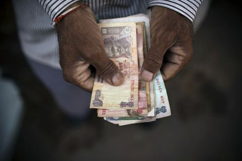 Indian Rupee Slides to Record on Deficit, U.S. Stimulus Concerns