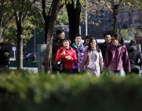 China Income Gap Narrows While Staying at Levels Risking Unrest