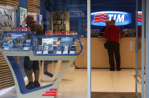 A Customer is Served Inside a TIM Store in Rome