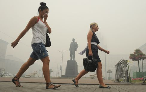 Russian women cover their faces to protect themselves