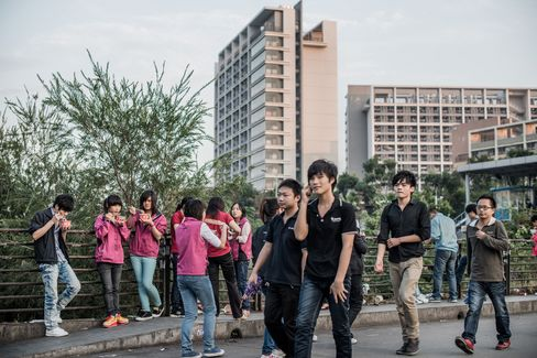 Employees are seen at the end of a work day outside Foxconn Technology Group's compound in Shenzhen. Many of the younger workers the company hoped to employ don't want to work in factories, said Auret van Heerden, chief executive officer of the Washington-based Fair Labor Association. Source: AFP/Getty Images