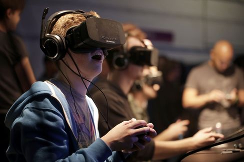 Gamers Wear Oculus Virtual Reality Headsets