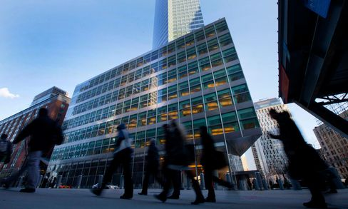 Pedestrians walk past Goldman Sachs Group headquarters in New York City. A Bloomberg News analysis of the filings shows that Goldman Sachs had 62 percent of its $134 billion in fair-value derivatives assets and liabilities in non-U.S. branches or subsidiaries for internation