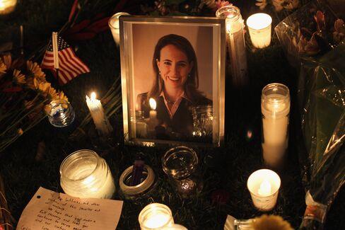 Candles surround a portrait of Gabrielle Giffords