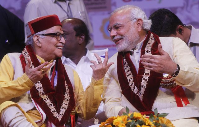 """Murli Manohar Joshi and Narendra Modi, architects of a party and a manifesto""""that only includes everything and everyone, which India is made of."""" Photographer: Sanjeev Verma/Hindustan Times via Getty Images"""