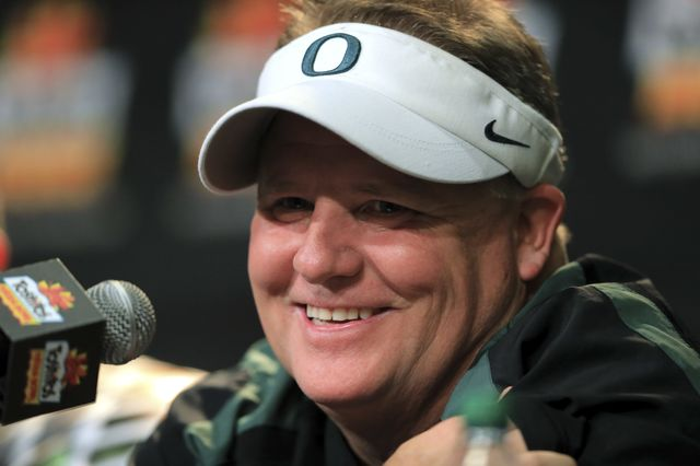 University of Oregon head football coach Chip Kelly smiles during a post-game press conference after winning the Tostitos Fiesta Bowl in Glendale, Arizona, on Jan. 3, 2013. Photographer: Doug Pensinger/Getty Images