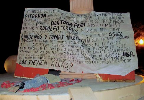 Alfonso Peña Arguelles was murdered in 2011 and his body was dumped at the Christopher Columbus monument in Nuevo Laredo, Mexico, under a banner calling his brother Antonio 'a money-laundering murderer living in the U.S.'