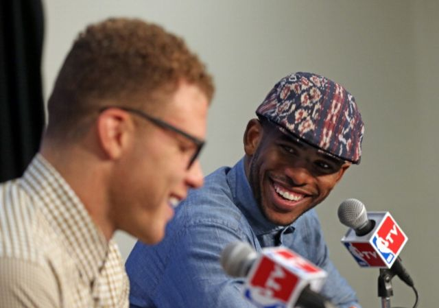 Blake and CP3, smiling because they'll have a new boss next season?Photographer: Layne Murdoch/NBAE via Getty Images