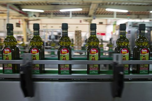 Bottles of Olive Oil Move Along the Carbonell Production Line