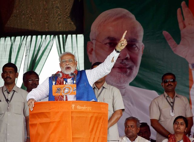 Narendra Modi's tasks range from difficult to impossible. Photographer: Ajay Aggarwal/Hindustan Times via Getty Images