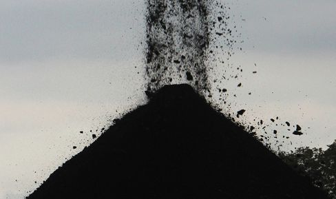 Coal, whose burning spews about twice the greenhouse gases as natural gas, is not in retreat. In 2011, coal was used to generate 30.3 percent of the world's primary energy, the highest level since 1969, according to the World Coal Association, an industry trade group. That share slipped only to 29.9 percent last year. Photographer: Dadang Tri/Bloomberg