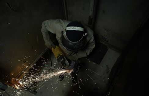 A Student Grinds Metal during a Welding Class