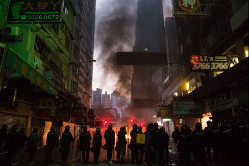 Rioters clash with police in the Mong Kok district.