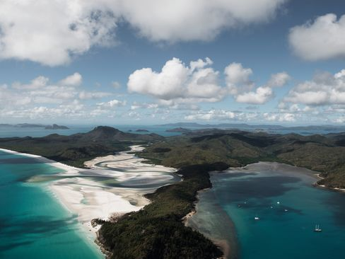 The legendary resort islands of Australia's Great Barrier Reef have been a sinkhole of investment dollars for decades. Whitehaven Beach, at far left, is on Whitsunday, the largest island in the Whitsunday archipelago.  Photograph: Ambroise Tezenas/Bloomberg Pursuits