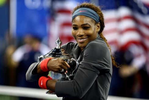 Tennis player Serena Williams of the United States of America smiles as she poses with the trophy after winning her women's singles final match against Victoria Azarenka of Belarus on Day Fourteen of the 2013 U.S. Open in New York City, on September 8, 2013. Photographer: Al Bello/Getty Images