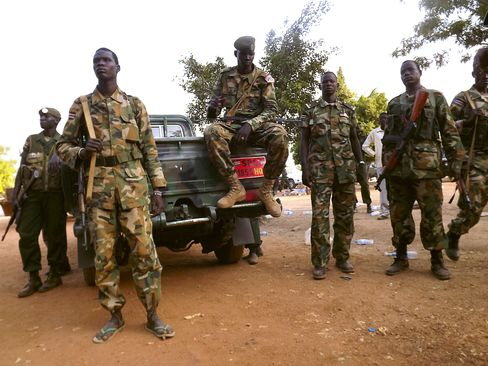 South Sudanese Soldiers Gather near a Truck in Juba
