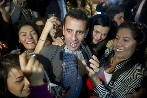 Venezuelan presidential candidate Henrique Capriles's youth, energy, and record of competent governance in Miranda make him a credible challenger to Chavez, Venezuela's chief political figure for 13 years. Photographer: Eitan Abramovich/AFP/Getty Images