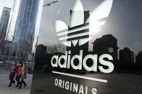 Adidas Shares Slide as 2012 Profit Forecast Misses Estimates