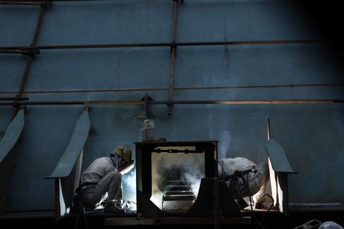 Workers weld a steel frame at the China CSSC Holdings Ltd. Chengxi Shipyard in Jiangyin. Photographer: Qilai Shen/Bloomberg