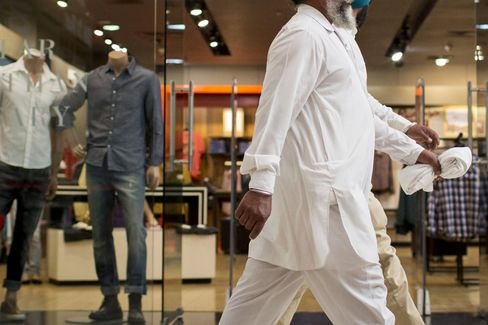 Pot Bellies Transform $2,000 Suits as Indians Swell