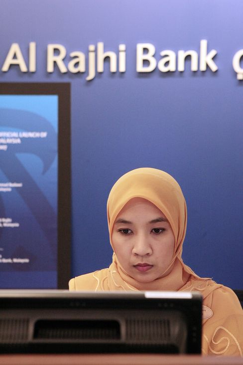 An Employee Works at the Al Rajhi Bank in Kuala Lumpur
