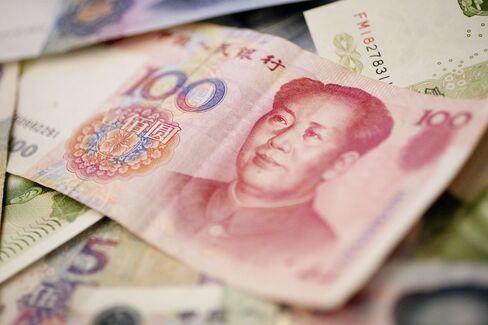 Yuan Deposits Rising Fuel Hong Kong's Peg Debate