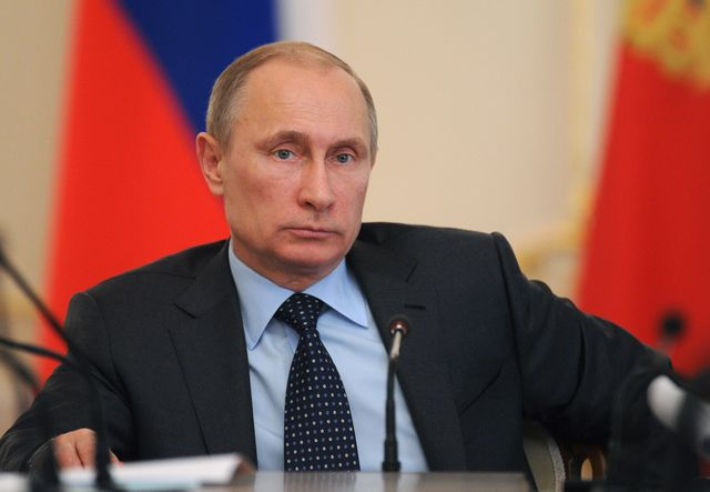 A face only a mother could believe.Photographer: Mikhail Klimentyev/AFP/Getty Images