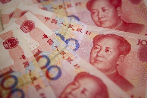 Yuan Intervention Eases as Slowdown Curbs Inflows