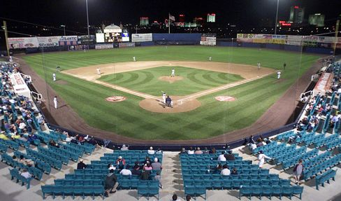 The Atlantic City Surf and Long Island Ducks play a night game before deserted stands at The Sandcastle minor league stadium on July 24, 2000. Photographer: Chris Polk/AP Photo