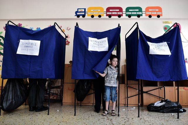 Voting and waiting for growth in Greece. Photographer: Aris Messinis/AFP/Getty Images