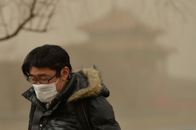 Man wearing a mask to combat the smog in Beijing, China. Photographer: Mark Ralston/AFP via Getty Images