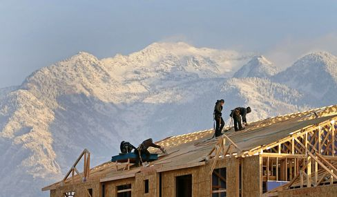 Contractors work on the roof of a new residential apartment building in Sandy, Utah, on Jan. 15, 2013. Photographer: George Frey/Bloomberg