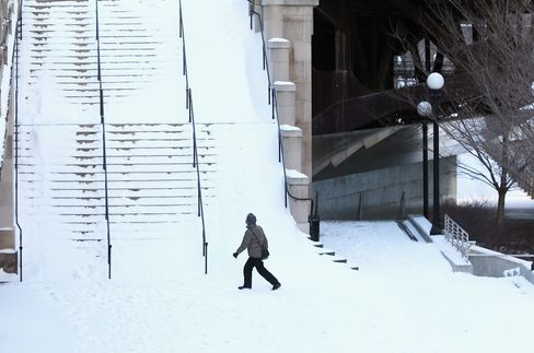A Pedestrian Walks Towards a Snow-Covered Stairway in Chicago