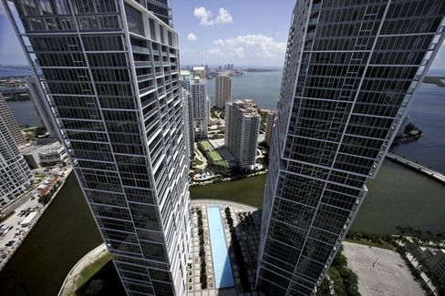 Two towers of the Brickell Icon condo development stand in Miami. Photographer: Eliot J. Schechter/Bloomberg