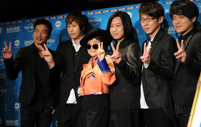 That's Yoko Ono along with Taiwanese rock band Mayday, which seems to have given the wrong signal to mainland China. Photographer: Toshifumi Kitamura/AFP/Getty Images