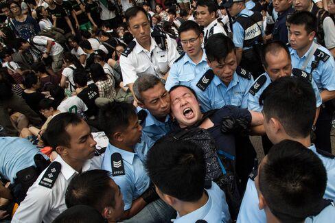 Police Remove Protesters