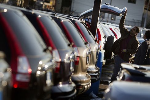 Americans are saving less and spending more for purchases such as new automobiles, as household net worth climbs with rising home values and stock indexes surging to record highs