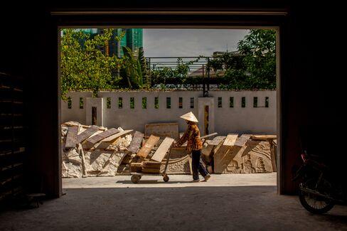 Cobweb-Covered Crates Signal Vietnam Slowdown as Debts Mount