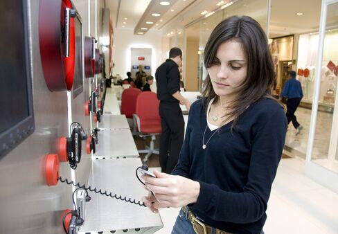 Slim's Wireless Hit as Economy Hinders Prices