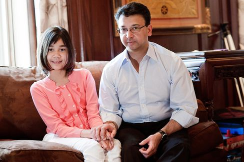 Dinakar Singh, founder of TPG-Axon Capital Management LP, right, and his daughter Arya Singh, 11, sit for a photograph in their home in New York on June 30, 2011. Photographer: Paul Taggart/Bloomberg