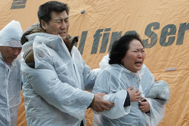 Even as South Koreans grieve, they demand competence and answers from their government.Photographer: Chung Sung-Jun/Getty Images