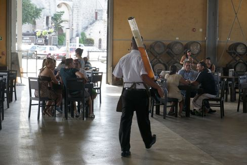 A waiter delivers beer at a microbrewery in Havana's old port.